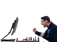 caucasian man winning chess against computer concept on isolated white background