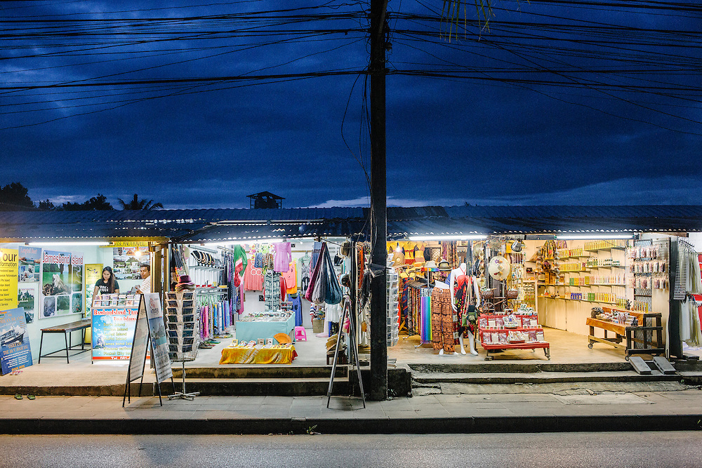 Local tourist shops on the main high street in Bang Niang. Much of Khao Lak is rebuilt showing little trace of the tragedy that happened 10 year ago when the tsunami swept its coastline. This area was one of the hardest hit on that fateful day of 26 Dec 2012.
