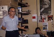 Sergio Serafini, administrator of Radio Popolare (Popular Radio) speaks during a meeting of the workers' cooperative of the radio at the headquarter in Santo Stefano square, Milan, 1991. Radio Popolare is an Italian free and indipendent radio station; its programs are broadcasted on FM and streaming and by satellite. &copy; Carlo Cerchioli<br /> <br /> Sergio Serafini amministratore di Radio Popolare parla durante un'assemblea della cooperativa dei lavoratori della radio nella sede di piazza Santo Stefano, Milano, 1991. Radio Popolare, &egrave; una radio di informazione libera e indipendente; i suoi programmi sono trasmessi in FM e streaming e via satellite.