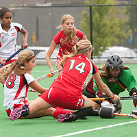 Leesa Gerlings from the Ontario Team 1 (14 red) tries to get control of the ball while Sofia Pisano (18 white) from Ontario Team 2 and Ontario Team 2 goalkeeper Jessica Lierman (2 green) try to stop the score in  the Field Hockey Canada Under 16 National Championship preliminaries at Cassie Campbell on Wednesday.  Ontario Team 1  finished the game with a 4-0 win.