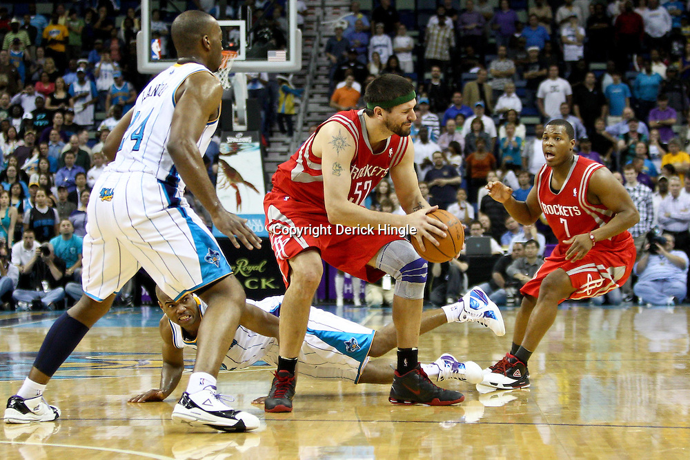 April 6, 2011; New Orleans, LA, USA; Houston Rockets center Brad Miller (52) fouls New Orleans Hornets point guard Jarrett Jack (floor) during the fourth quarter at the New Orleans Arena. The Hornets defeated the Rockets 101-93 and clinched a playoff spot with the victory.   Mandatory Credit: Derick E. Hingle-US PRESSWIRE
