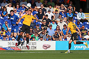 AFC Wimbledon defender Ryan Delaney (21) winning header during the EFL Sky Bet League 1 match between AFC Wimbledon and Bristol Rovers at the Cherry Red Records Stadium, Kingston, England on 21 September 2019.