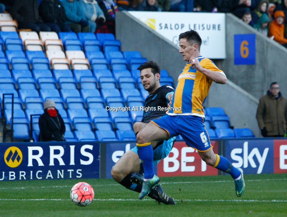 30.01.2016. New Meadow, Shrewsbury, England. Emirates FA Cup 4th Round. Shrewsbury versus Sheffield Wednesday. Sheffield Wednesday defender Vincent Sasso challenges Shrewsbury Town midfielder Ian Black.