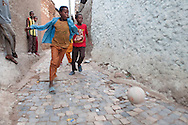 Boys play football in the narrow streets of Harar, Ethiopia.