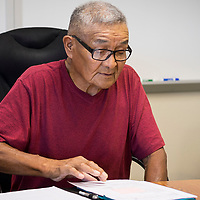 Raymond Benally, 75, explains his dealings with Tate Auto Center of Gallup at the Karigan Professional Office Complex in Saint Michaels, AZ.
