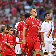 Ricki Lambert heads onto the pitch with the Liverpool team  during the Liverpool Vs AS Roma friendly pre season football match at Fenway Park, Boston. USA. 23rd July 2014. Photo Tim Clayton
