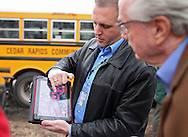 Cedar Rapids Recreation Superintendent Sven Leff (from left) shows a property map to City Council member Scott Olson as members of the Northwest Recreation Center Task Force take a bus tour of the five possible sites for a new recreation center in Cedar Rapids on Thursday morning, February 23, 2012. (Stephen Mally/Freelance)