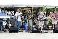(from left) John DeBoer, Kenny Collins, Tom Davis, Gary Marcum (drums, behind Marcum,) Mark Fraze, Jim Daily; aka The Stumps perform in the Lincoln Park Commons area of the Holiday at Home festival, Sunday, September 6, 2009.
