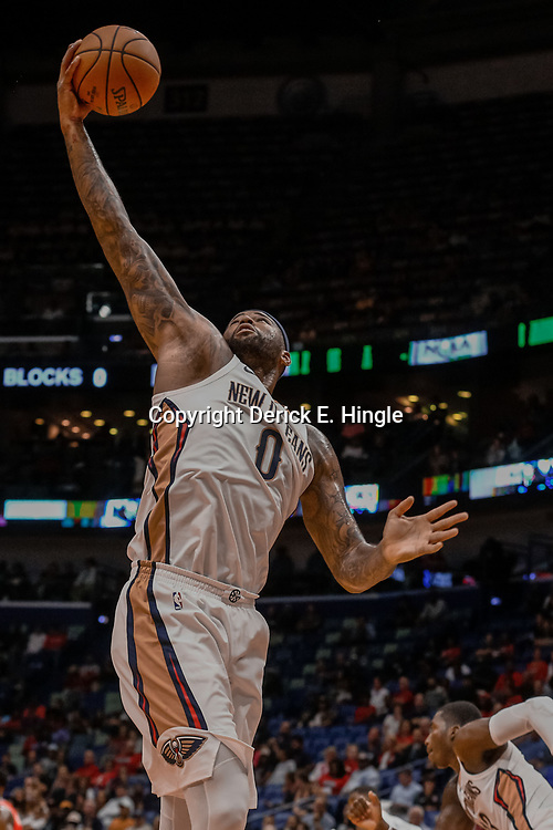 Oct 3, 2017; New Orleans, LA, USA; New Orleans Pelicans forward DeMarcus Cousins (0) rebounds against the Chicago Bulls during the first half of a NBA preseason game at the Smoothie King Center. Mandatory Credit: Derick E. Hingle-USA TODAY Sports