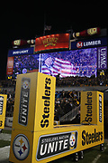 The Pittsburgh Steelers scoreboard shows the National Anthem activities during the NFL week 10 regular season football game against the Carolina Panthers on Thursday, Nov. 8, 2018 in Pittsburgh. The Steelers won the game 52-21. (©Paul Anthony Spinelli)