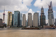 Huangpu River activity with the skyline of Lujiazui Shanghai, China