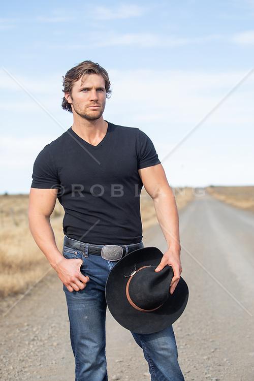 hot cowboy on a dirt road