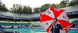 03.08.2011, Tennis Stadion, Kitzbuehel, AUT, ATP World Tour, Bet-at-Home Cup Kitzbuehel, im Bild Turnierdirektor Alexander Antonic, auf dem Center Court mit einem Schirm. Der EX- Tennisprofi betete zum Wettergott, jedoch half dies nichst. Der Spieltag musste um 19:30 Uhr abgesagt werden // during ATP World Tour Bet-at-Home Cup Kitzbuehel 2011 tennis tournier, men single at tennis stadium Kitzbuehel, Austria on 03/08/2011, EXPA Pictures © 2011, PhotoCredit: EXPA/ J. Feichter