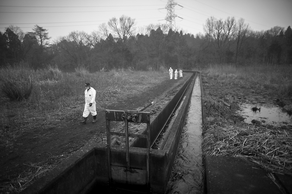 "Volunteer workers of the  Okuma town  ""Old Buffers"" Corps , in the Fukushima radioactive evacuation zone check on the water flow manly  for fire prevention""keeping the water going is part of the way we prepare for eventually going home""."