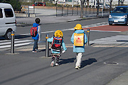 Japanese elementary schoolchildren walking to school