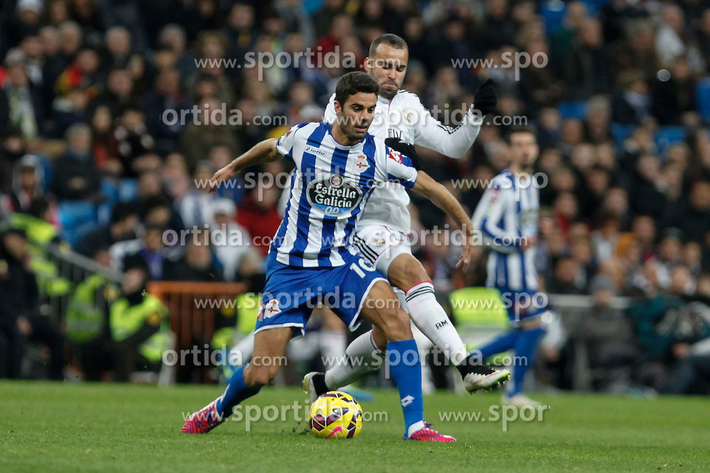 14.02.2015, Estadio Santiago Bernabeu, Madrid, ESP, Primera Division, Real Madrid vs Deportivo La Coruna, 23. Runde, im Bild Real Madrid&acute;s Jese Rodriguez (R) and Deportivo de la Coruna&acute;s Juan Dominguez // during the Spanish Primera Division 23rd round match between Real Madrid vs Deportivo La Coruna at the Estadio Santiago Bernabeu in Madrid, Spain on 2015/02/14. EXPA Pictures &copy; 2015, PhotoCredit: EXPA/ Alterphotos/ Victor Blanco<br /> <br /> *****ATTENTION - OUT of ESP, SUI*****