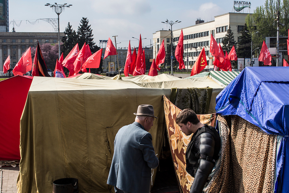 People attend a Communist May Day march and rally on Thursday, May 1, 2014 in Donetsk, Ukraine.