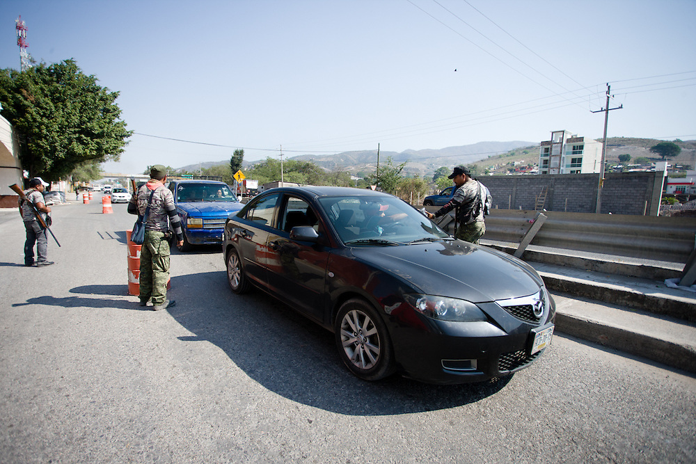A road checkpoint staffed by members of FUSDEG check for suspicious cars and collect donations from supporters.