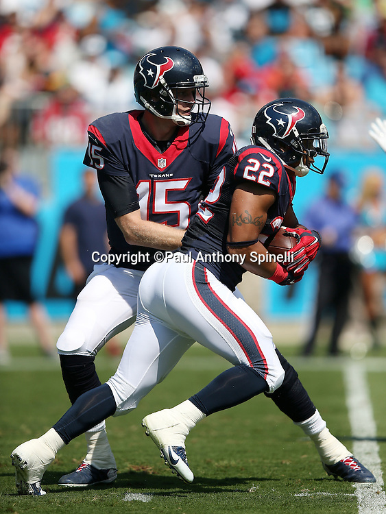 Houston Texans quarterback Ryan Mallett (15) hands off the ball to Houston Texans running back Chris Polk (22) during the 2015 NFL week 2 regular season football game against the Carolina Panthers on Sunday, Sept. 20, 2015 in Charlotte, N.C. The Panthers won the game 24-17. (©Paul Anthony Spinelli)