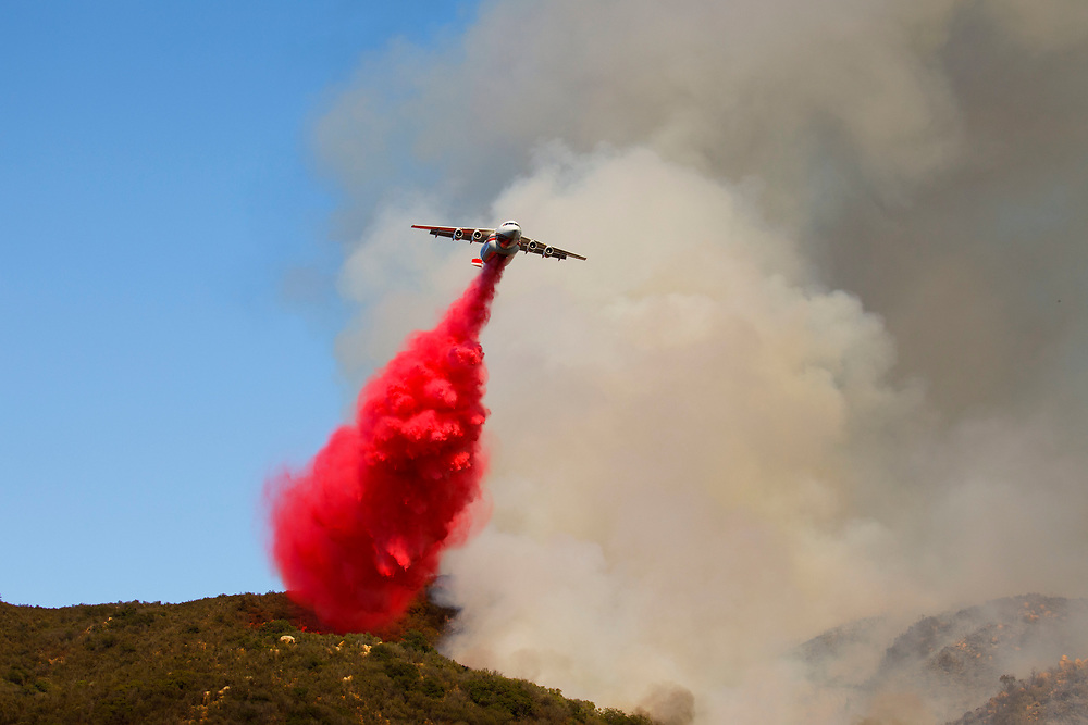 A firefighting aircraft battles the Wildomar wildfire in the Cleveland National Forest on Thursday, October 26, 2017 in Wildomar, Calif. The fire started after a motorcycle crashed into a tree. © 2017 Patrick T Fallon