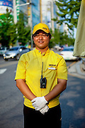 "Portrait of a young man working as a car adviser for a big shopping mall called ""E-Mart"" in the city of Daegu, South Korea."