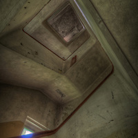 An abandoned Soviet sports hospital in East Germany with concrete stairwell