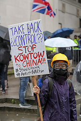 Pictured: Protesters highlighting the crackdown on protests in Hong Kong demonstrated outside the conference venue.<br /> <br /> protesters demonstrated on the first day of the Conservative Party conference in Manchester.<br /> <br /> © Dave Johnston / EEm