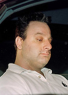 John Denofa, 35, of Buckingham, Pa., sits in a police cruiser waiting to be transported to Bucks County Prison, after his arraignment, Friday, April 7, 2000, in Ottsville, Pa. Denofa is charged with the murder of Rachel Siani, the exotic dancer and college student. Siani's corpse was found April 1, in Burlington, NJ. (Photo by William Thomas Cain/Cain Images)