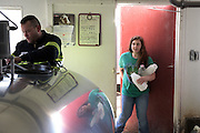 Brooke Parent hurries into the Green Acres milk house hoping to fill up on milk before milk hauler Tim Croteau empties the bulk tank and hauls it away, in South Randolph, Vt. Wednesday, April 13, 2016. (Valley News - James M. Patterson) Copyright Valley News. May not be reprinted or used online without permission. Send requests to permission@vnews.com.
