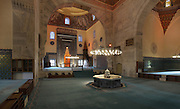 Prayer hall of the Green Mosque or Yesil Cami with the tiled mihrab on the Southern wall and iwan to the East, Bursa, Turkey. The mihrab has a moulded tile frame and its niche is crowned by twelve rows of mocarabe, with a six-ribbed shell on top. The Green Mosque was built under Sultan Mehmed Celebi in 1419-21 by the architect Haci Ivaz Pasha. The painted decorations were by Ali bin Ilyas and Mehmed el Mecnun. Following an earthquake in 1855, the building underwent an extensive renovation led by architect Leon Parvillee. Picture by Manuel Cohen