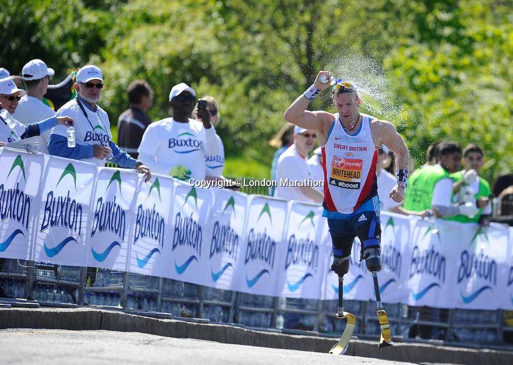IPC athlete Richard Whitehead cools off with Buxton water<br /> The Virgin Money London Marathon 2014<br /> 13 April 2014<br /> Photo: Javier Garcia/Virgin Money London Marathon<br /> media@london-marathon.co.uk