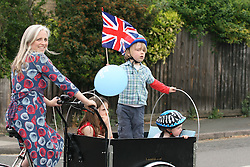 Cambridge, UK  29/04/2011. The Royal Wedding of HRH Prince William to Kate Middleton. Lady taking her children on a bicycle tour stopping by Kimberley Road Cambridge city centre. Photo credit should read Jason Patel/LNP. Please see special instructions. © under license to London News Pictures
