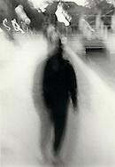 A blurred figure.