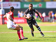 Fijian captain Osea Kolinisau looks to beat a French tackler  during the Emirates Dubai rugby sevens match between Fiji  and France  at the Sevens Stadium, Al Ain Road, United Arab Emirates on 3 December 2016. Photo by Ian  Muir.*** during the Emirates Dubai rugby sevens match between *** and *** at the Sevens Stadium, Al Ain Road, United Arab Emirates on 3 December 2016. Photo by Ian  Muir.