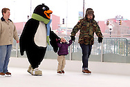 (from left) Marcy Thomas of Huber Heights, Parker the Penquin, Cecilia Fernandez, 2 of Tipp City and Craig Thomas of Columbus during a session with the ice rink's mascot at the RiverScape MetroPark in downtown Dayton, Sunday, January 22, 2012.