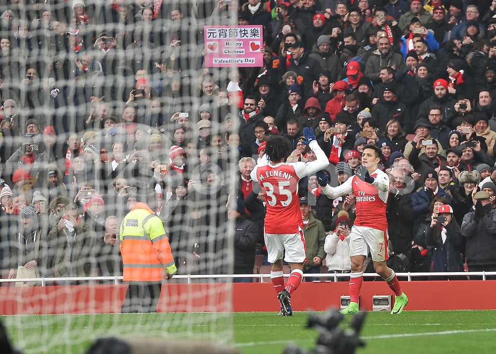 Alexis Sánchez of Arsenal celebrates scoring with Mohamed Elneny of Arsenal during the Premier League match between Arsenal and Hull City at the Emirates Stadium, London, England on 11 February 2017. Photo by Vince  Mignott.