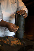 Sous Chef Sujith Arlyaratne makes cinnamon paste using a cinnamon stick and a dash of water at the Nugagama Restaurant at the Cinnamon Grand Hotel in central Colombo. The restaurant is renowned for its traditional 'village' Sri Lankan food with every dish using cinnamon in some degree.