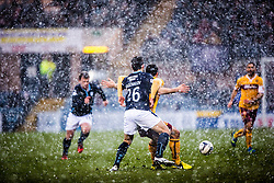 Motherwell's John Sutton holds Dundee's Kostadin Gadzhalov. <br /> Dundee 4 v 1 Motherwell, SPFL Premiership played 10/1/2015 at Dundee's home ground Dens Park.