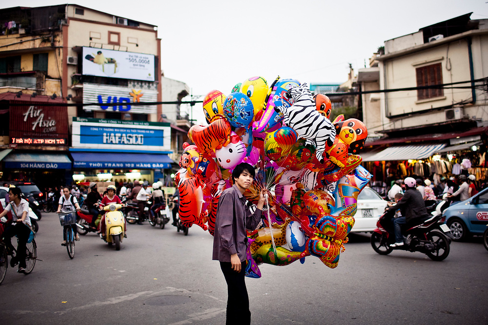 A balloon seller in the Old Quarter of Hanoi, Vietnam.