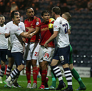 Paul Hungtington and Dexter Blackstock clash during the Sky Bet Championship match between Preston North End and Nottingham Forest at Deepdale, Preston, England on 3 November 2015. Photo by Pete Burns.