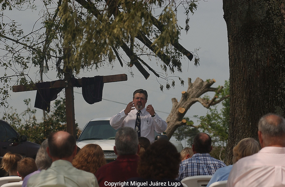 Rainsville, Alabama: Brown's Chapel Baptist Church pastor Brian Keith delivers a sermon under a sprawling oak tree the first Sunday after tornados ripped through this rural northeastern Alabama town. The congregation held services outdoors in solidarity with other churches destroyed in the tornados, and as a sign of faith to passersby. (PHOTO: MIGUEL JUAREZ LUGO)