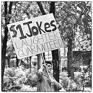 It is interesting to see what people will come up with to make money. Here is 26-year-old Jason Schneider, a wanna be stand-up comedian selling jokes on The Mall in Central Park, New York City.