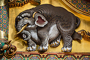 "An imagined elephant carving by an artist who had never seen one. Toshogu Shrine is the final resting place of Tokugawa Ieyasu, the founder of the Tokugawa Shogunate that ruled Japan for over 250 years until 1868. Ieyasu is enshrined at Toshogu as the deity Tosho Daigongen, ""Great Deity of the East Shining Light"". Initially a relatively simple mausoleum, Toshogu was enlarged into the spectacular complex seen today by Ieyasu's grandson Iemitsu during the first half of the 1600s. The lavishly decorated shrine complex consists of more than a dozen buildings set in a beautiful forest. Countless wood carvings and large amounts of gold leaf were used to decorate the buildings in a way not seen elsewhere in Japan. Toshogu contains both Shinto and Buddhist elements, as was common until the Meiji Period when Shinto was deliberately separated from Buddhism. Toshogu is part of Shrines and Temples of Nikko UNESCO World Heritage site."