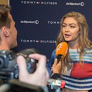 NLD/Amsterdam/201702017- Gigi Hadid brengt flitsbezoek ter promotie van haar Tommy X GiGi Spring '17 collectie, Gigi Hadid
