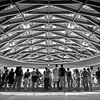 A crowd of people watching dancers under the dome at Robson Square