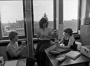 """Erin Foods Promotion.      (N91)..1981..03.09.1981..09.03.1981..3rd September 1981..As part of an advertising campaign to promote Erin Foods """"Little Dinners"""", Erin took the promotion nationwide. Here we see three office girls enjoying the """"Little Dinner"""" as a tasty snack at lunch time...Image shows three young ladies enjoying a tasty """"Little Dinner""""snack at lunch time in their office..If you know these three ladies why not contact us at irishphotoarchive@gmail.com and we will gladly add their names to the image."""