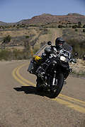 Bill Dragoo on BMW R1200 GS Adventure rounding curve in New Mexico