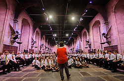 © Licensed to London News Pictures. 06/09/2013 Watford, UK. Kerrie Clarke Deputy Head teacher of Queens School, Watford takes the  first assembly of the school year inside Hogwarts Great Hall, at the Warner Btothers Harry Potter Studio Tour.  Photo credit : Simon Jacobs/LNP