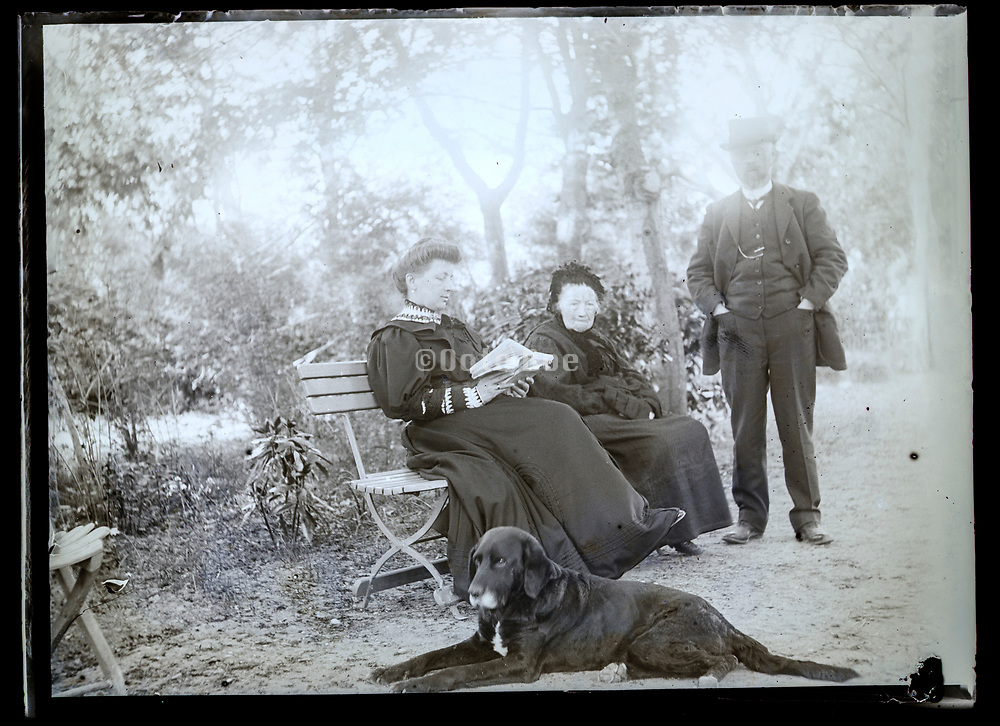 adults and grandmother with dog in the garden France ca 1920s