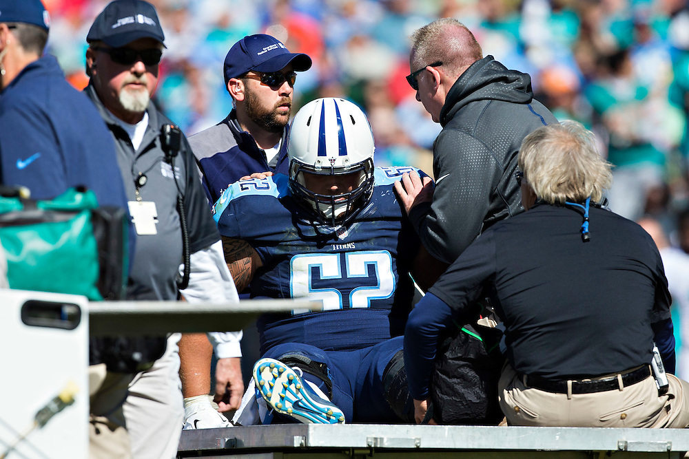 NASHVILLE, TN - OCTOBER 18:  Brian Schwenke #62 of the Tennessee Titans is carted off the field after being hurt during a game against the Miami Dolphins at LP Field on October 18, 2015 in Nashville, Tennessee.  The Dolphins defeated the Titans 38-10.  (Photo by Wesley Hitt/Getty Images) *** Local Caption *** Brian Schwenke